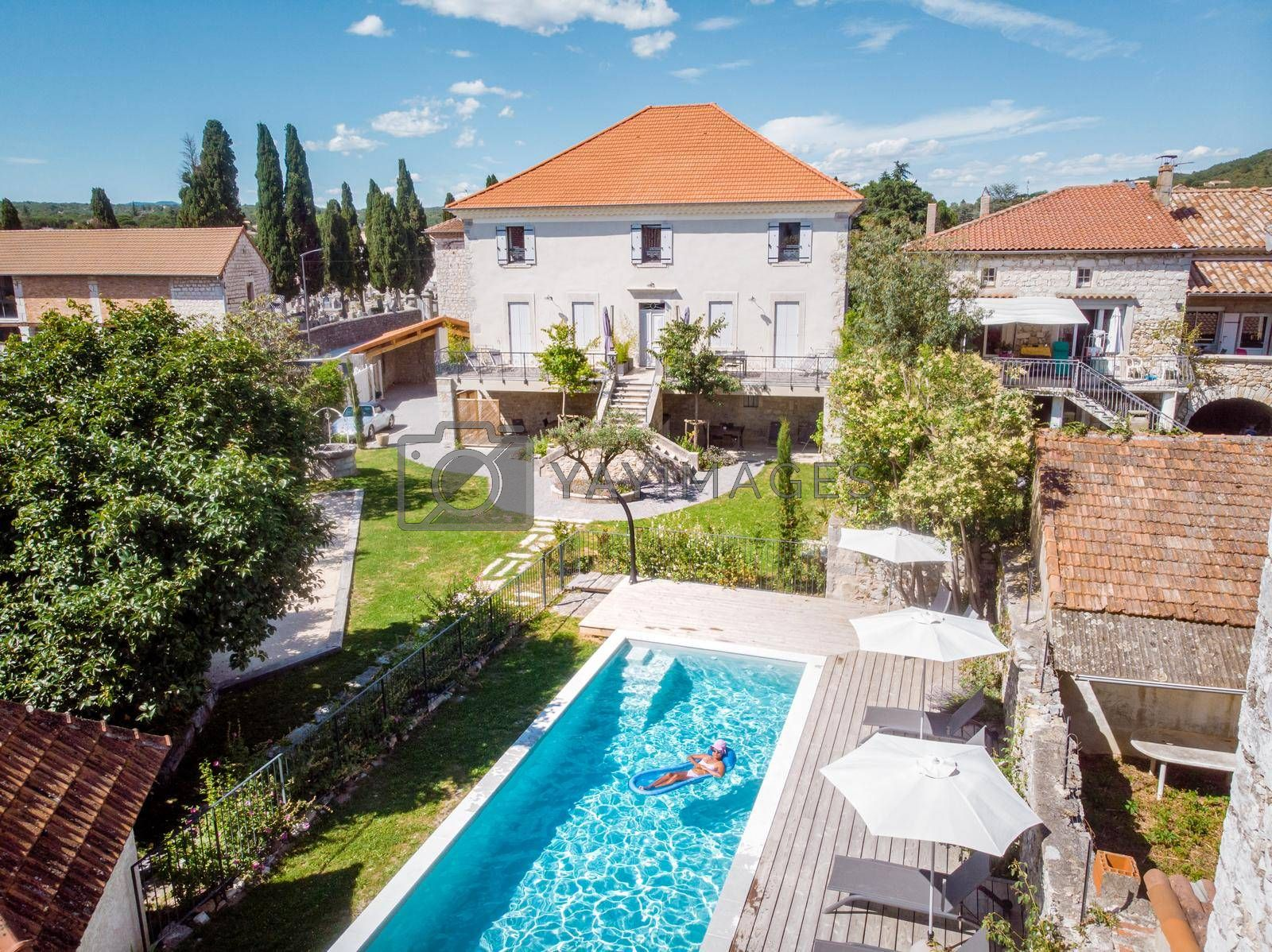 two person swim in the pool at the hotel. View from above, couple men and women in swimming pool of luxury vacation home in the Ardeche France Europe
