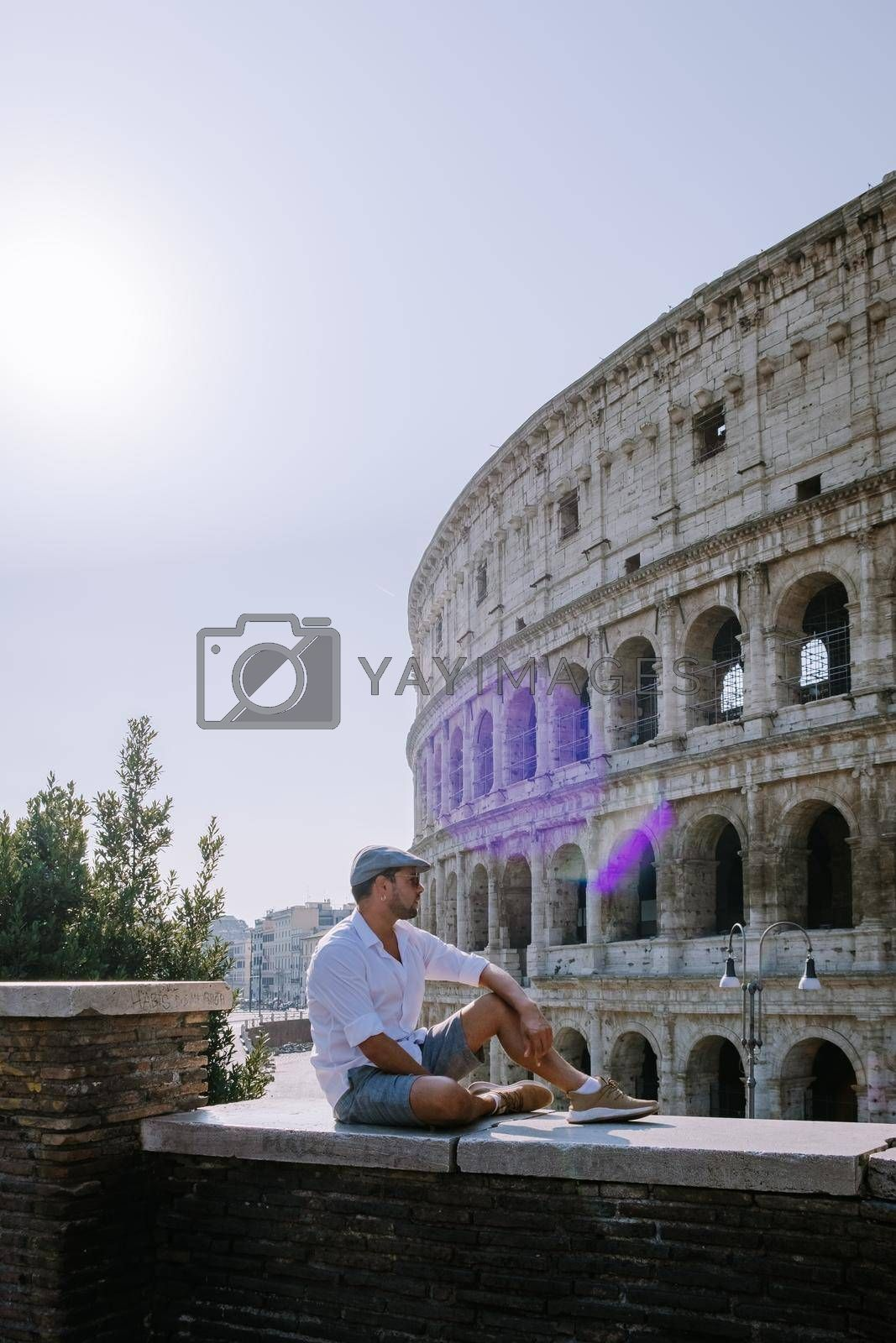 View of Colosseum in Rome and morning sun, Italy, Europe. young guy on city trip Rome