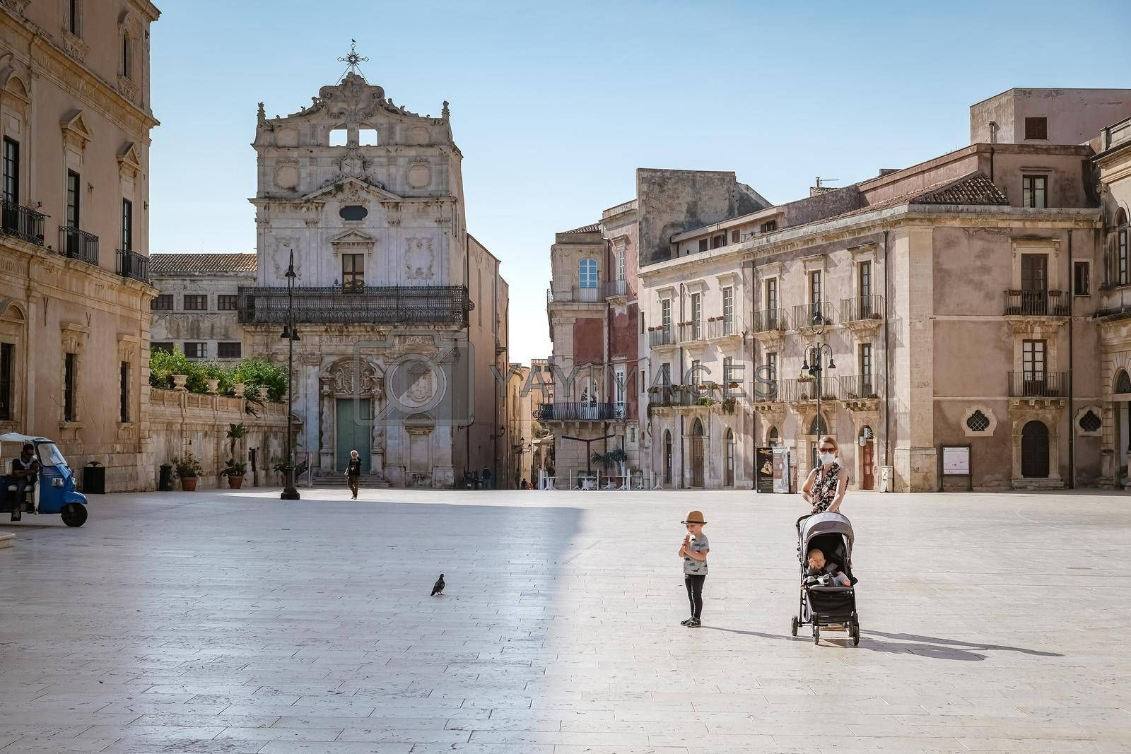 Ortigia in Syracuse Sicily Italy October 2020 in the Morning. Travel Photography from Syracuse, Italy on the island of Sicily. Cathedral Plaza and market with people wearing face protection during the 2020 pandemic covid 19 corona virus