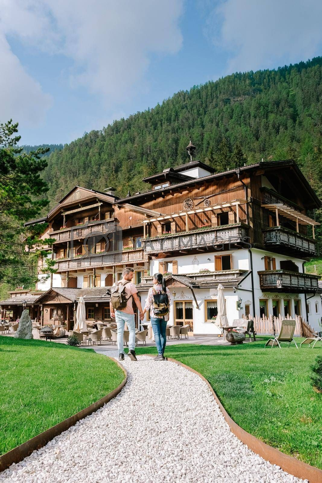 Royalty free image of couple men and woman on vacatian in the Italian Dolomites Italy by fokkebok