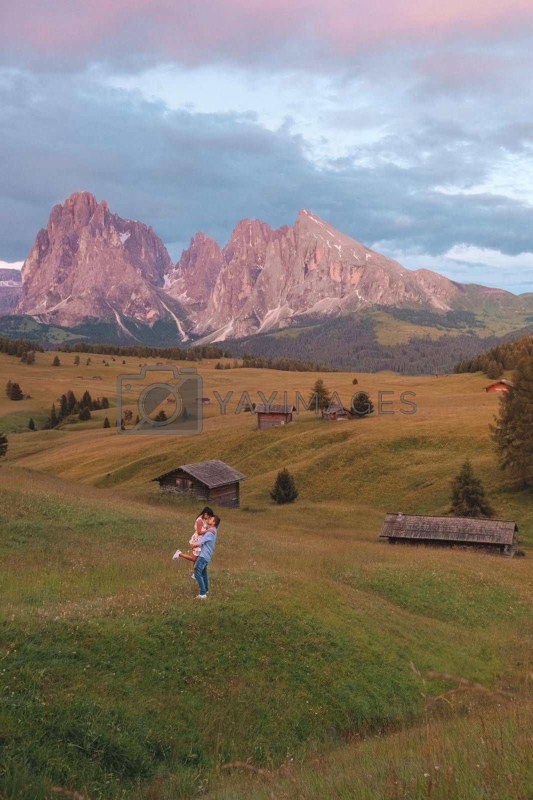 Royalty free image of couple mid age men and woman visiting the Italian Dolomites in Italy Alpe di Susi, Seiser alm by fokkebok