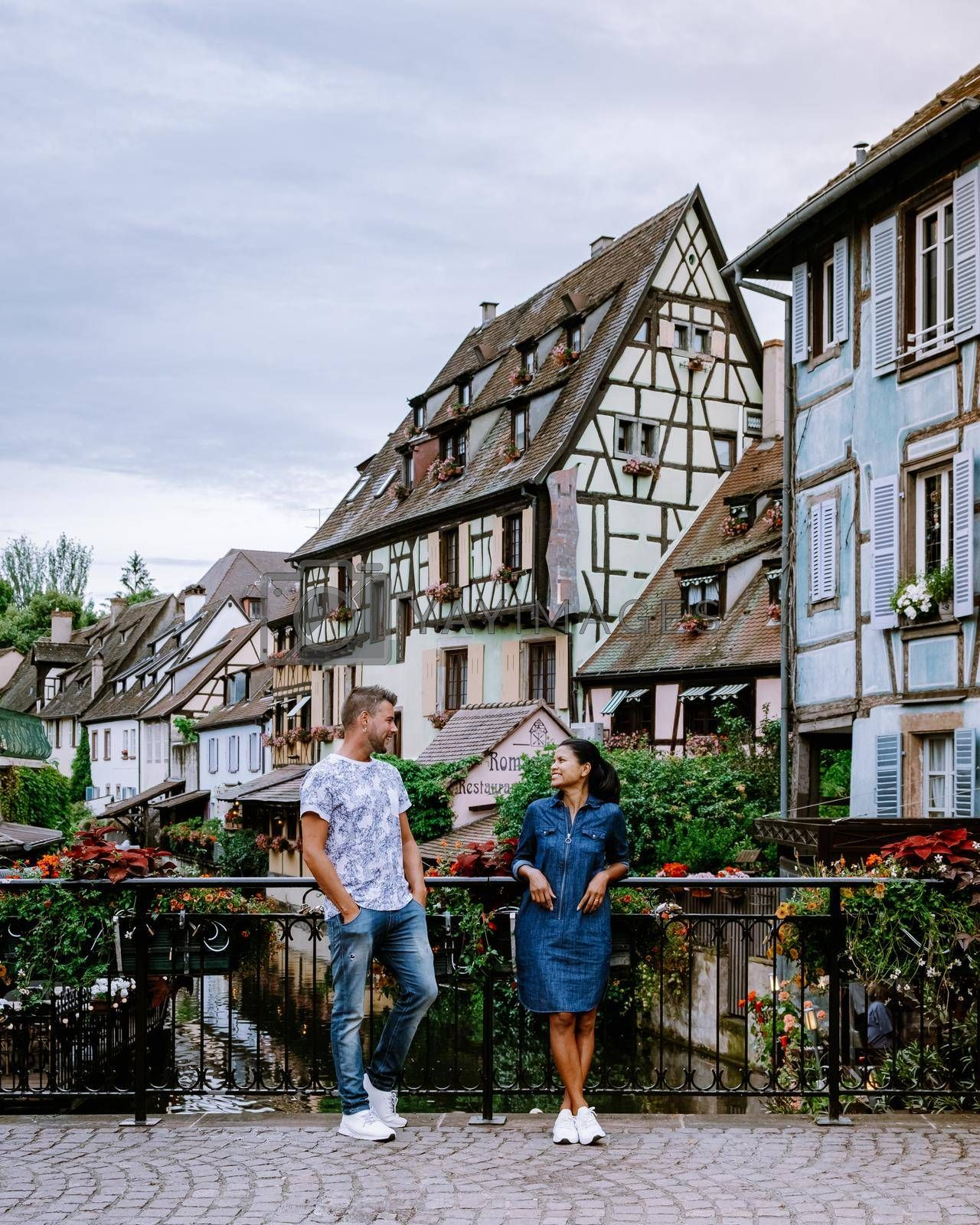 Royalty free image of couple on city trip Colmar, Alsace, France. Petite Venice, water canal and traditional half timbered houses. Colmar is a charming town in Alsace, France. Beautiful view of colorful romantic city Colmar, France, Alsace by fokkebok