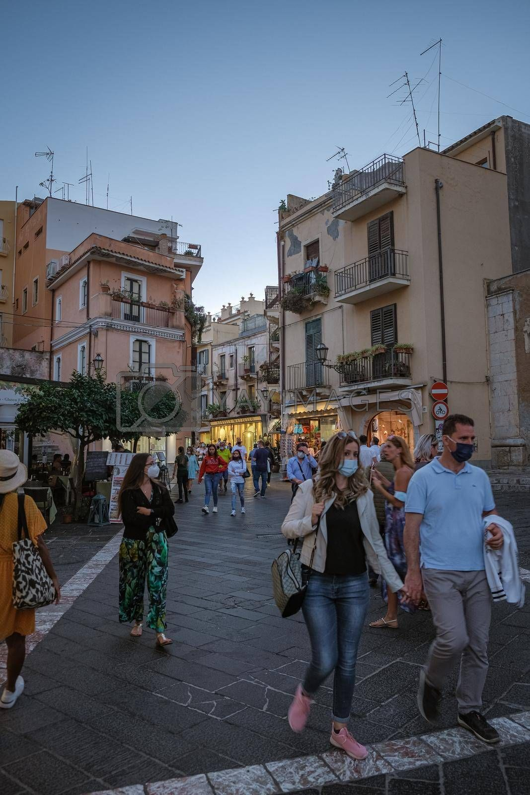 Royalty free image of Taormina Sicily , people on the streets using fase mask during the pandemic Corona Covid 19 virus outbreak by fokkebok