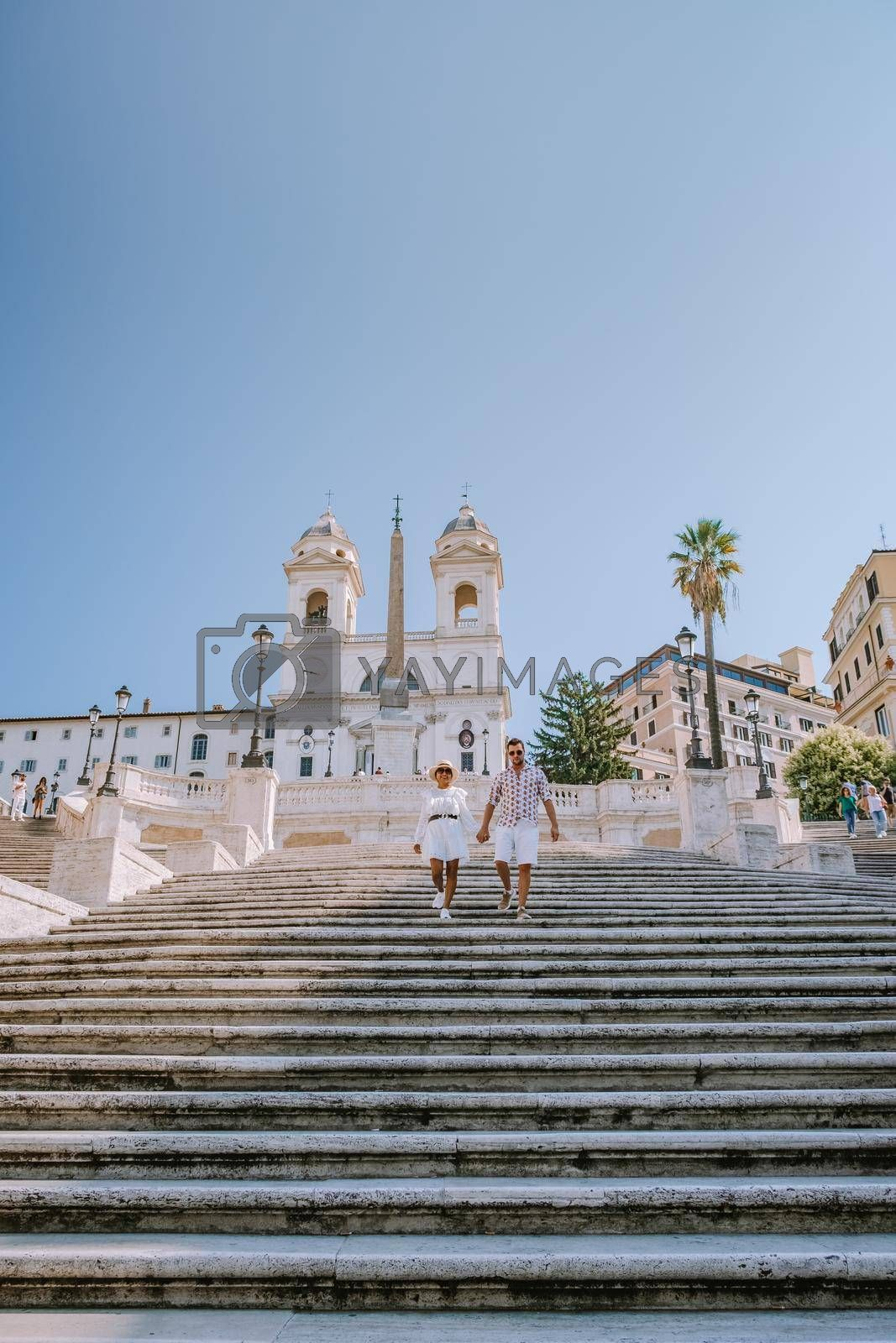 Rome September 2020, The Spanish Steps in Rome, Italy. The famous place is a great example of Roman Baroque Style with people with mouth protection during the covid 19 outbreak Italy Corona virus