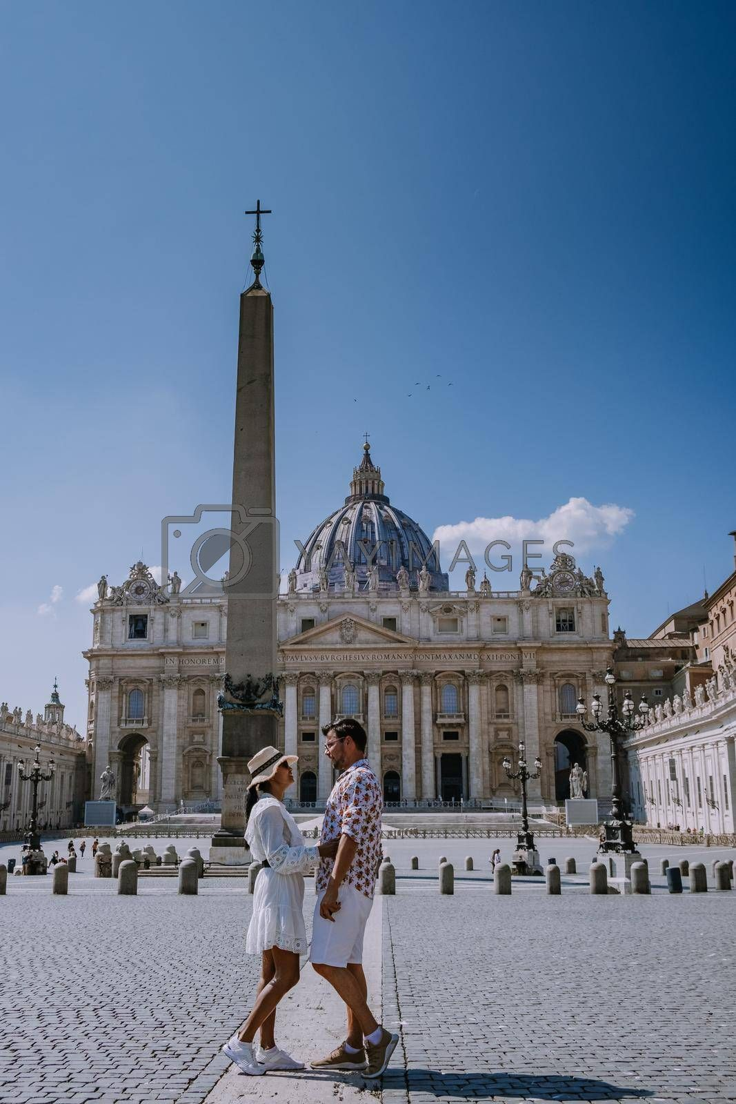 St. Peter's Basilica in the morning from Via della Conciliazione in Rome. Vatican City Rome Italy. Rome architecture and landmark. St. Peter's cathedral in Rome. Couple on city trip