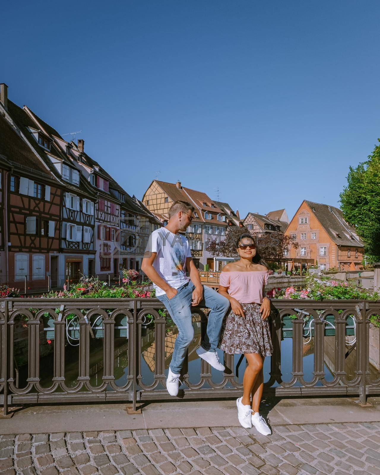 couple on city trip Colmar, Alsace, France. Petite Venice, water canal and traditional half timbered houses. Colmar is a charming town in Alsace, France. Beautiful view of colorful romantic city Colmar