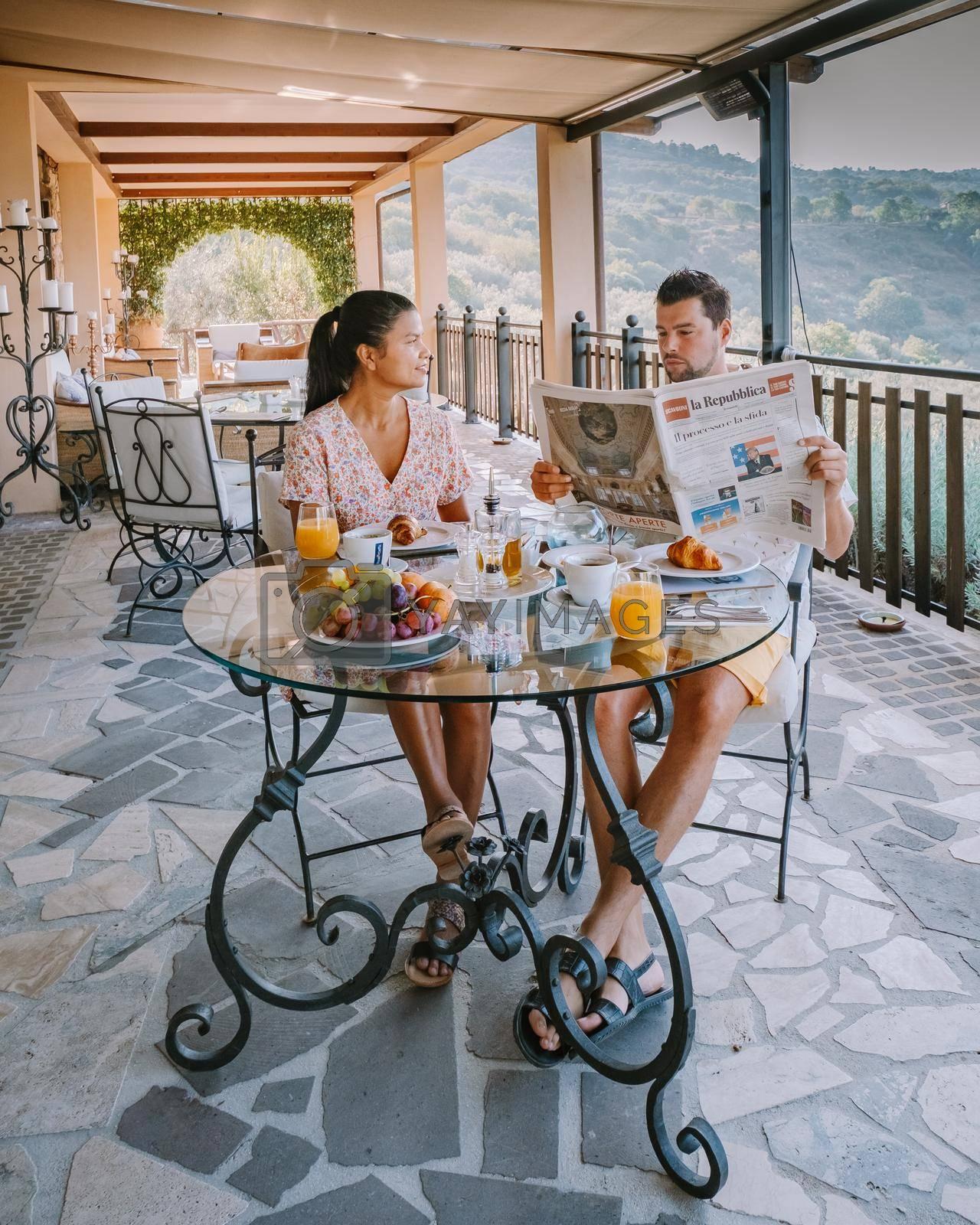couple having breakfast at luxury villa at the Italian country side near Rome Italy.