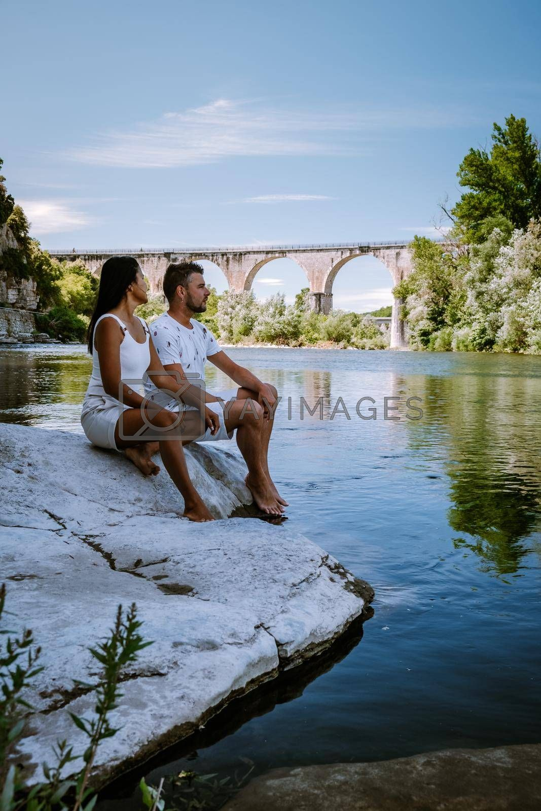 couple on vacation in Ardeche France, view of the village of Vogue in Ardeche. France Europe