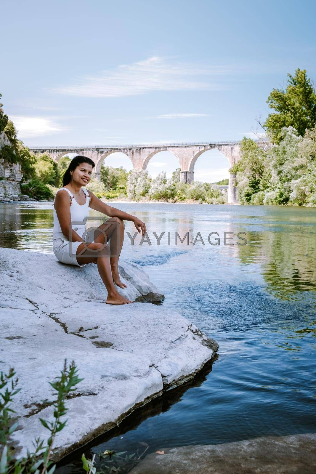 woman on vacation in Ardeche France, view of the village of Vogue in Ardeche. France Europe