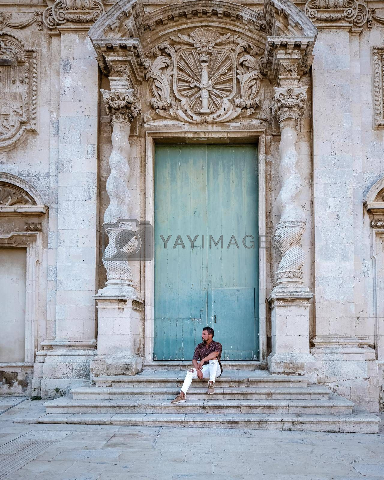 men on citytrip, Ortigia in Syracuse Sicily Italy in the Morning. Travel Photography from Syracuse, Italy on the island of Sicily.
