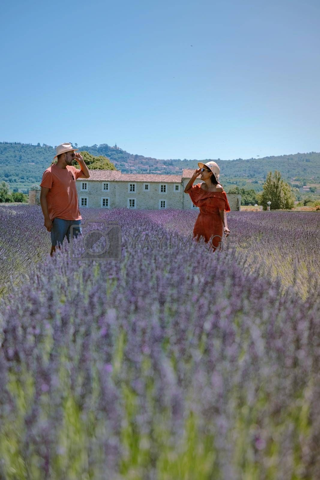 couple visit the old town of Gordes Provence,Blooming purple lavender fields at Senanque monastery, Provence, southern France. Europe