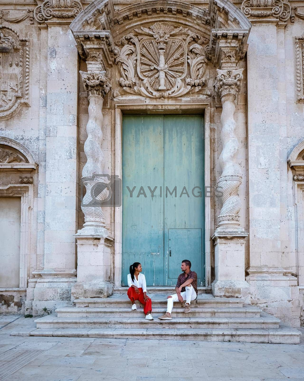 couple men and woman on citytrip, Ortigia in Syracuse Sicily Italy in the Morning. Travel Photography from Syracuse, Italy on the island of Sicily.