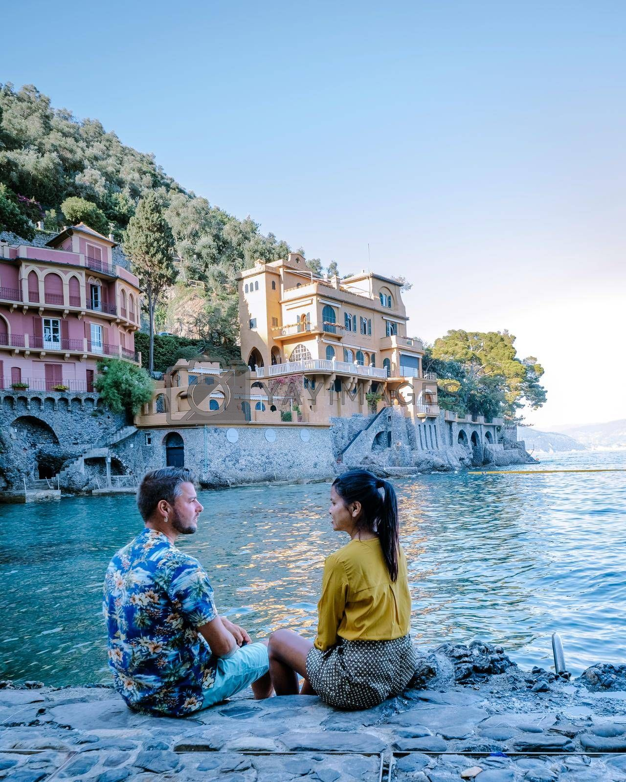 couple on vacation ligurian coast Italy,Portofino famous village bay, Italy Europe colorful village Ligurian coast