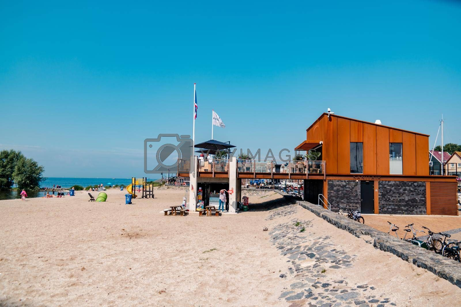 Urk Netherlands August 2020, harbor and lighthouse near the beach on a bright summer day Flevoland Urk Netherlands Europe, new restaurant pavilion on the beach