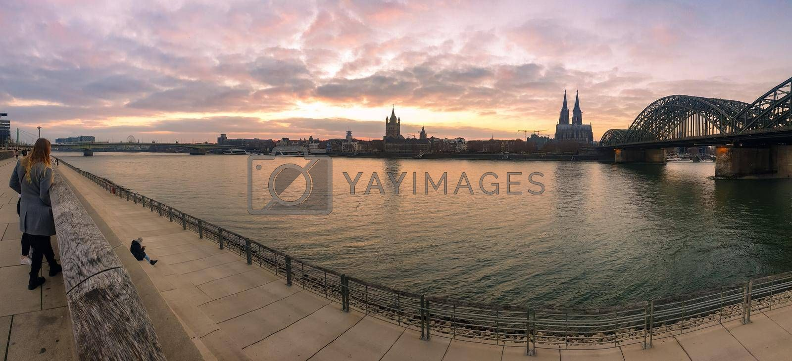 Cologne Germany alongside the rhein river during sunset with the huge Cathedral in Koln