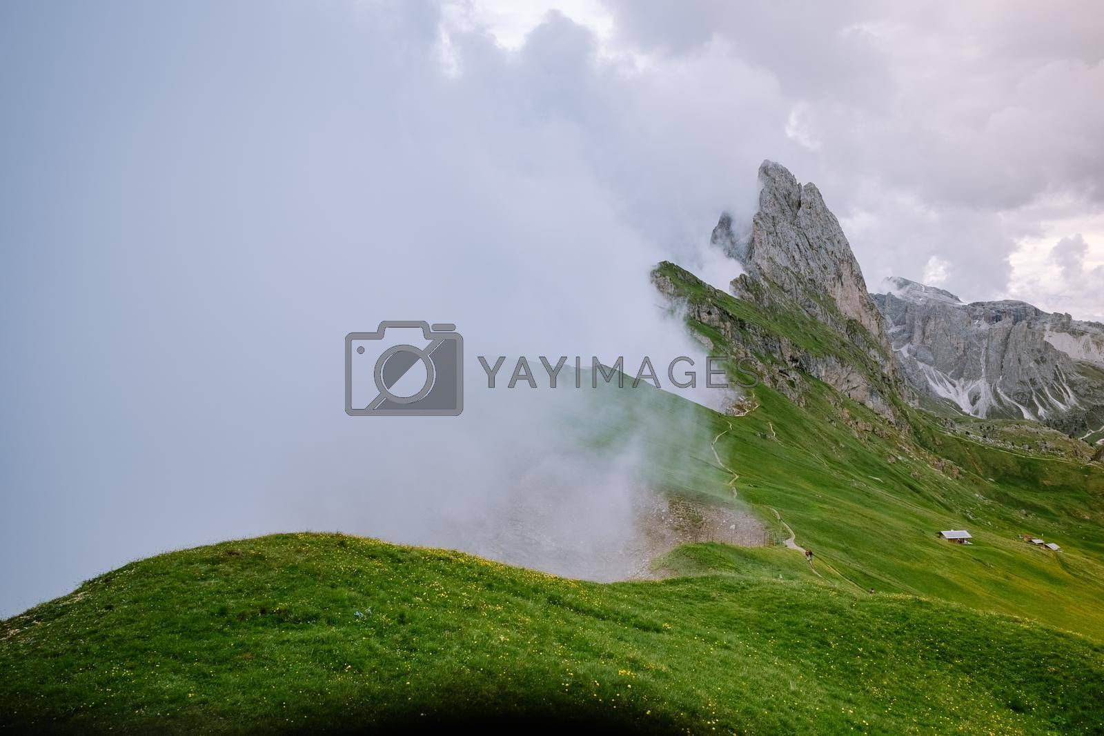 hiking in the Italien Dolomites, Amazing view on Seceda peak. Trentino Alto Adige, Dolomites Alps, South Tyrol, Italy, Europe. Odle mountain range, Val Gardena. Majestic Furchetta peak in morning sunlight. Italy