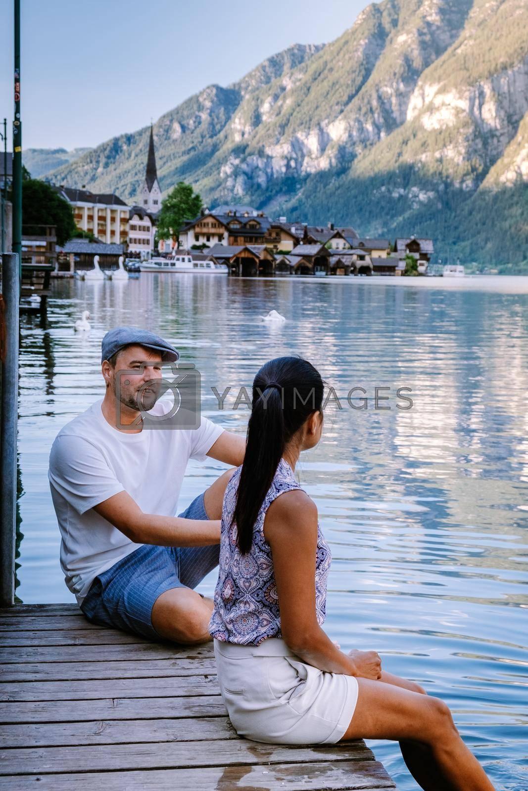 couple visit during summer vacation Hallstatt village on Hallstatter lake in Austrian Alps Austria Europe