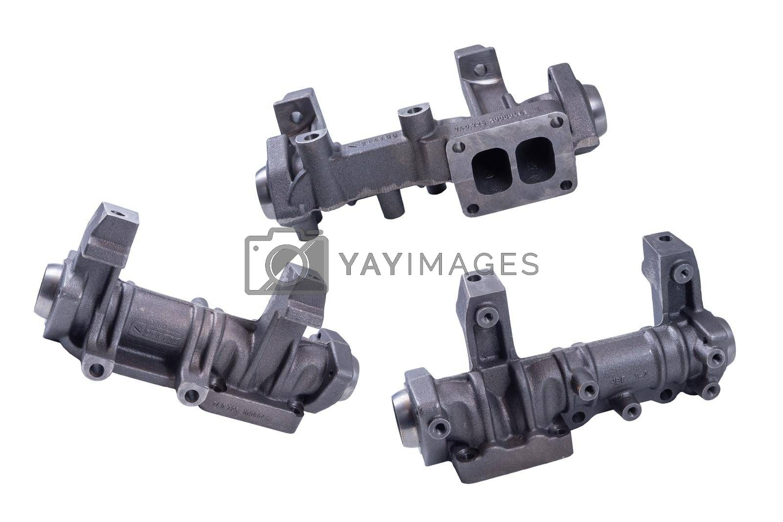 new exhaust manifold of a car on a white background. The front part of the exhaust system of the internal combustion engine exhaust gas.