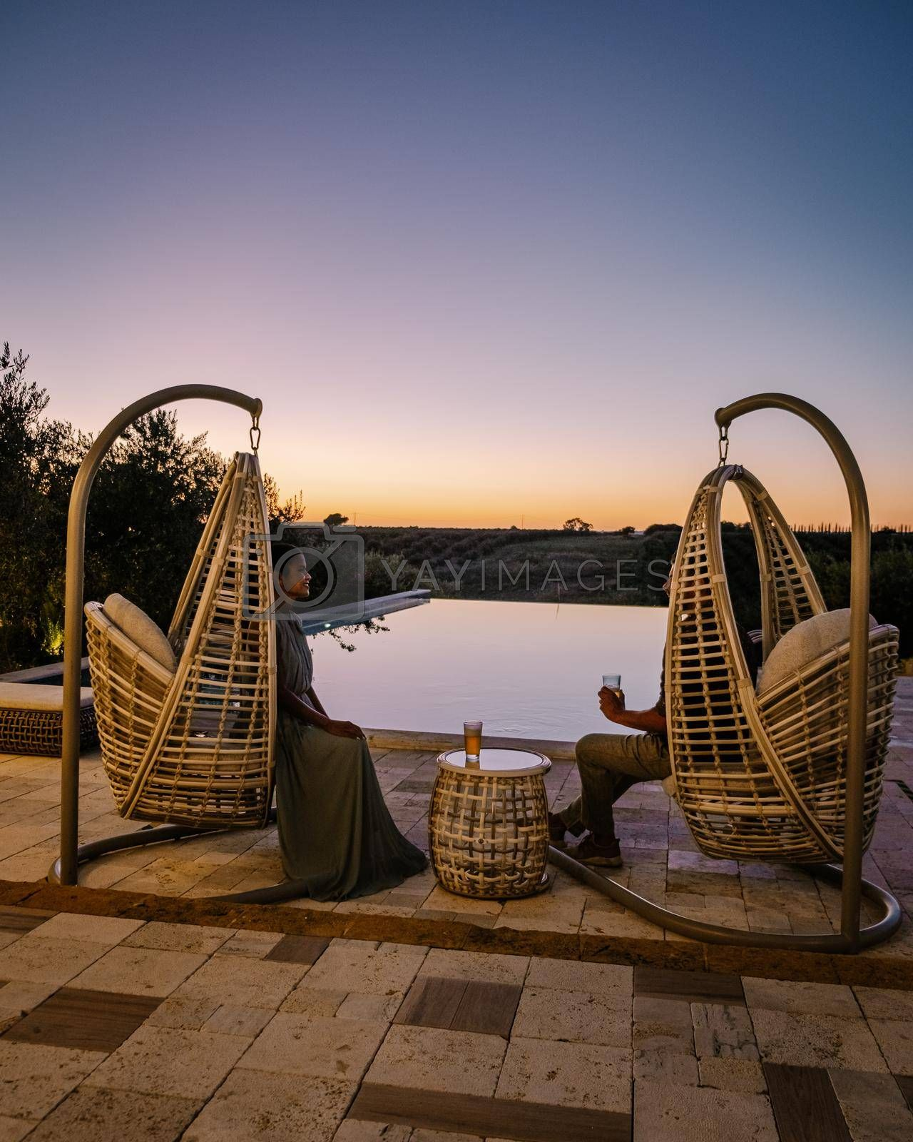Luxury resort with a view over the wine field in Selinunte Sicily Italy. infinity pool with a view over wine fields in Sicilia, couple on vacation at luxury resort