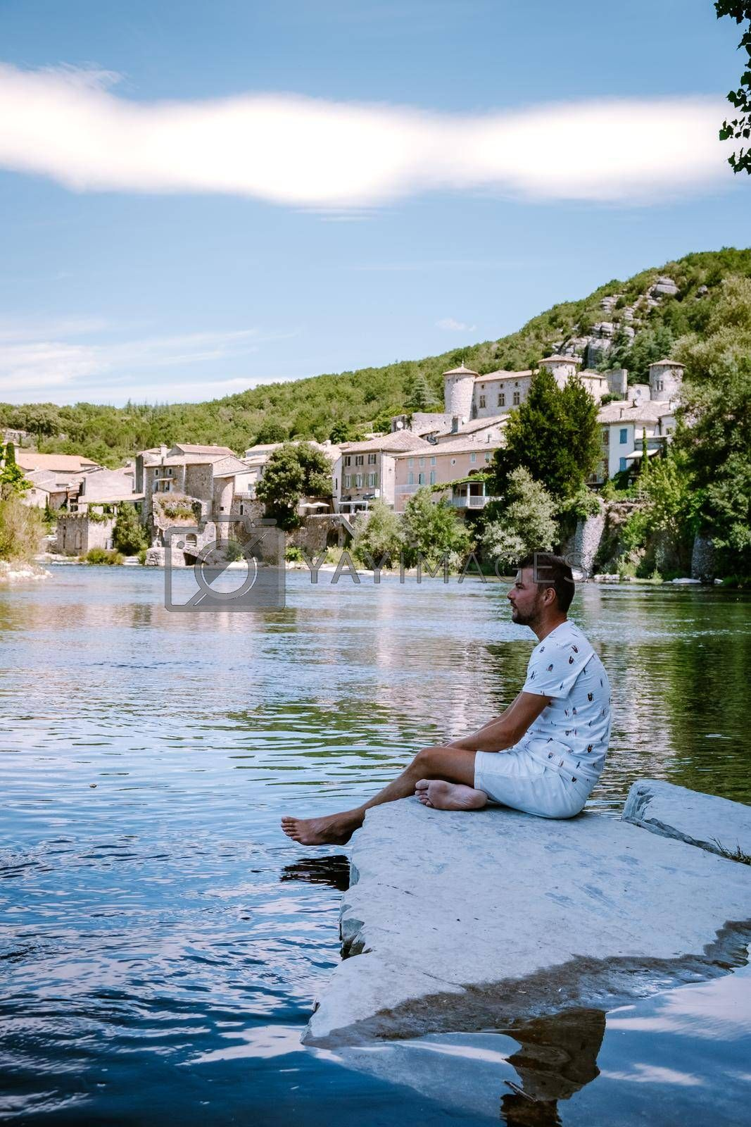 guy on vacation in Ardeche France, view of the village of Vogue in Ardeche. France Europe
