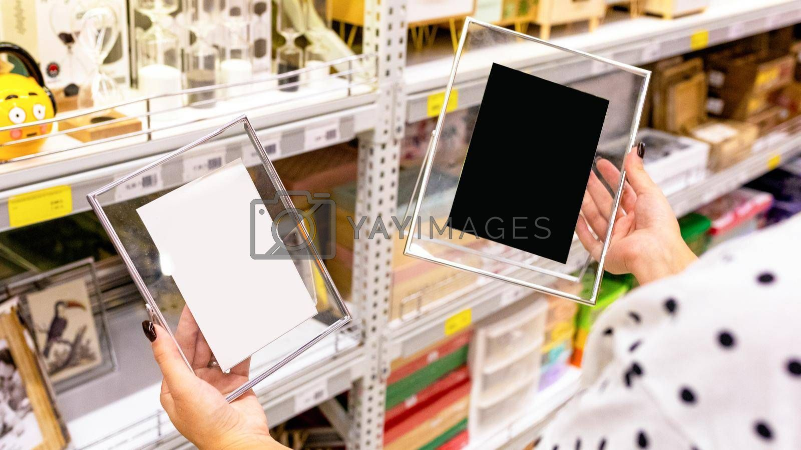 Woman holding transparent photo frames at the store