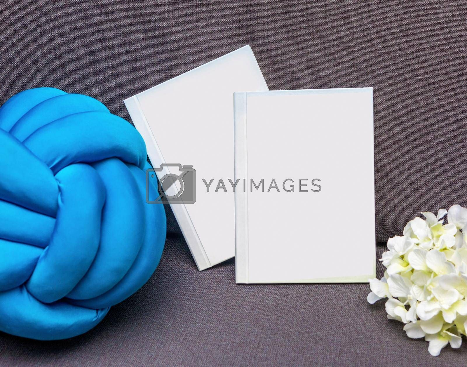 White postcard book with flower isolated
