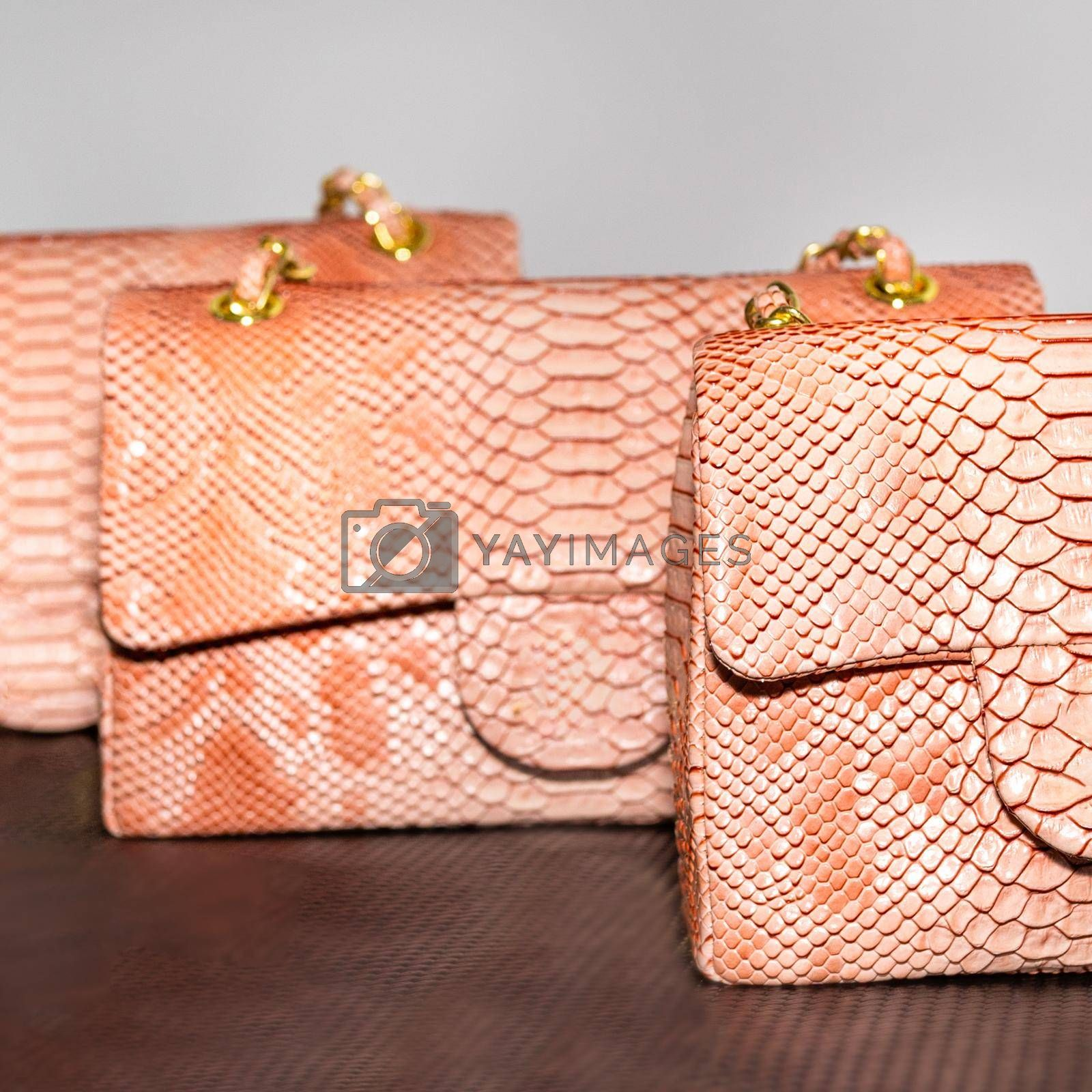 Pink decorated female bag on a white background isolated