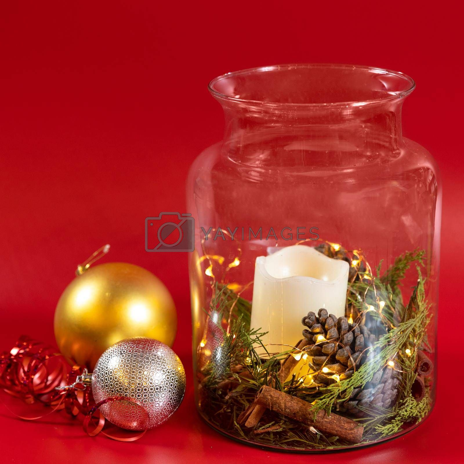 Christmas toy, decor, candle in the jar, red background