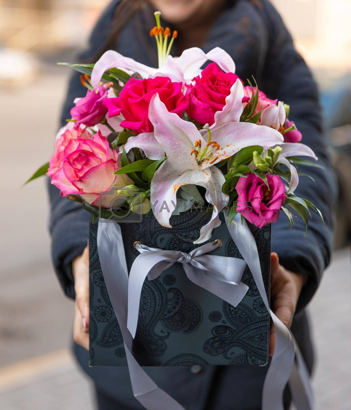 Woman holding beautiful flower bouquet in the box