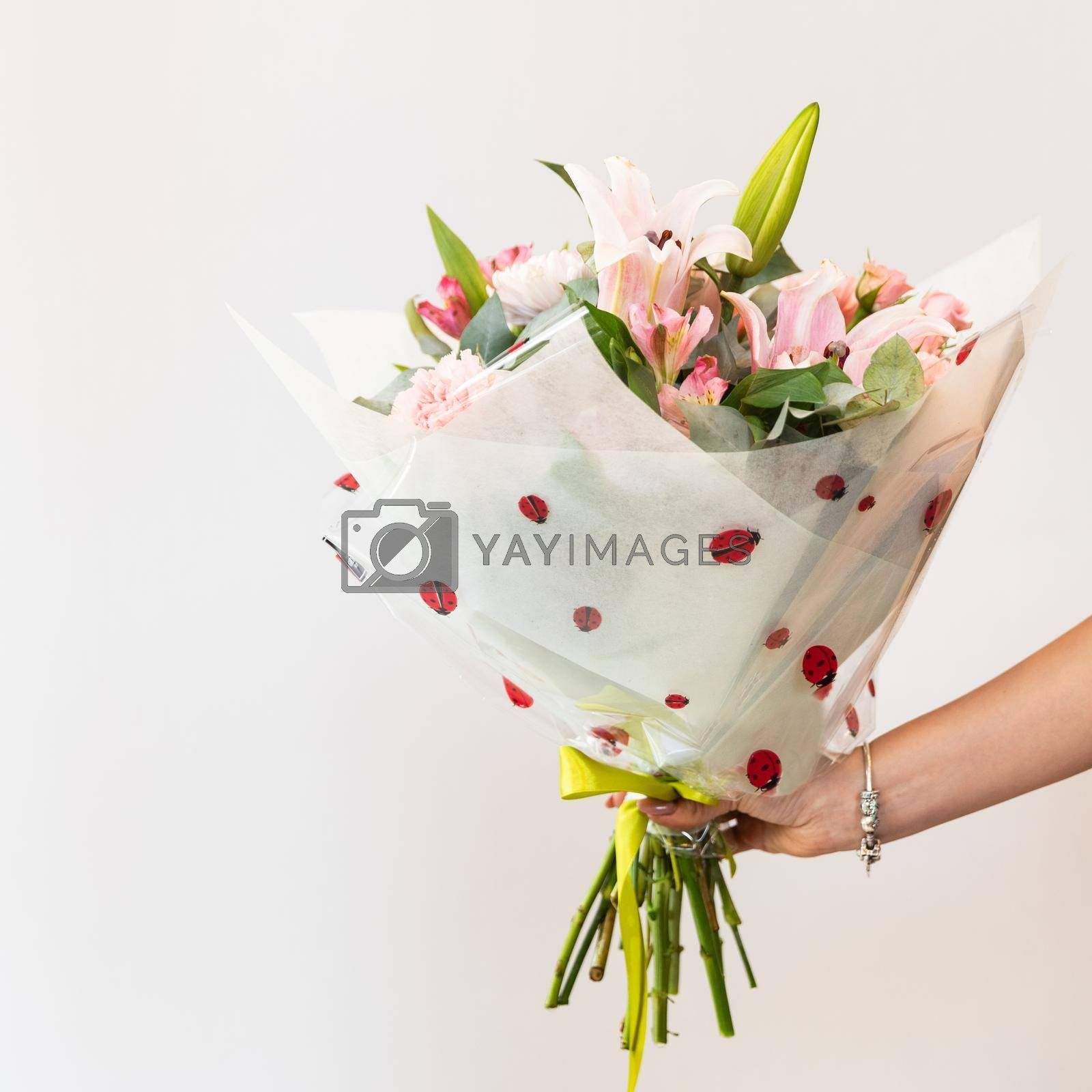 Woman holding colorful flower bouquet with white background