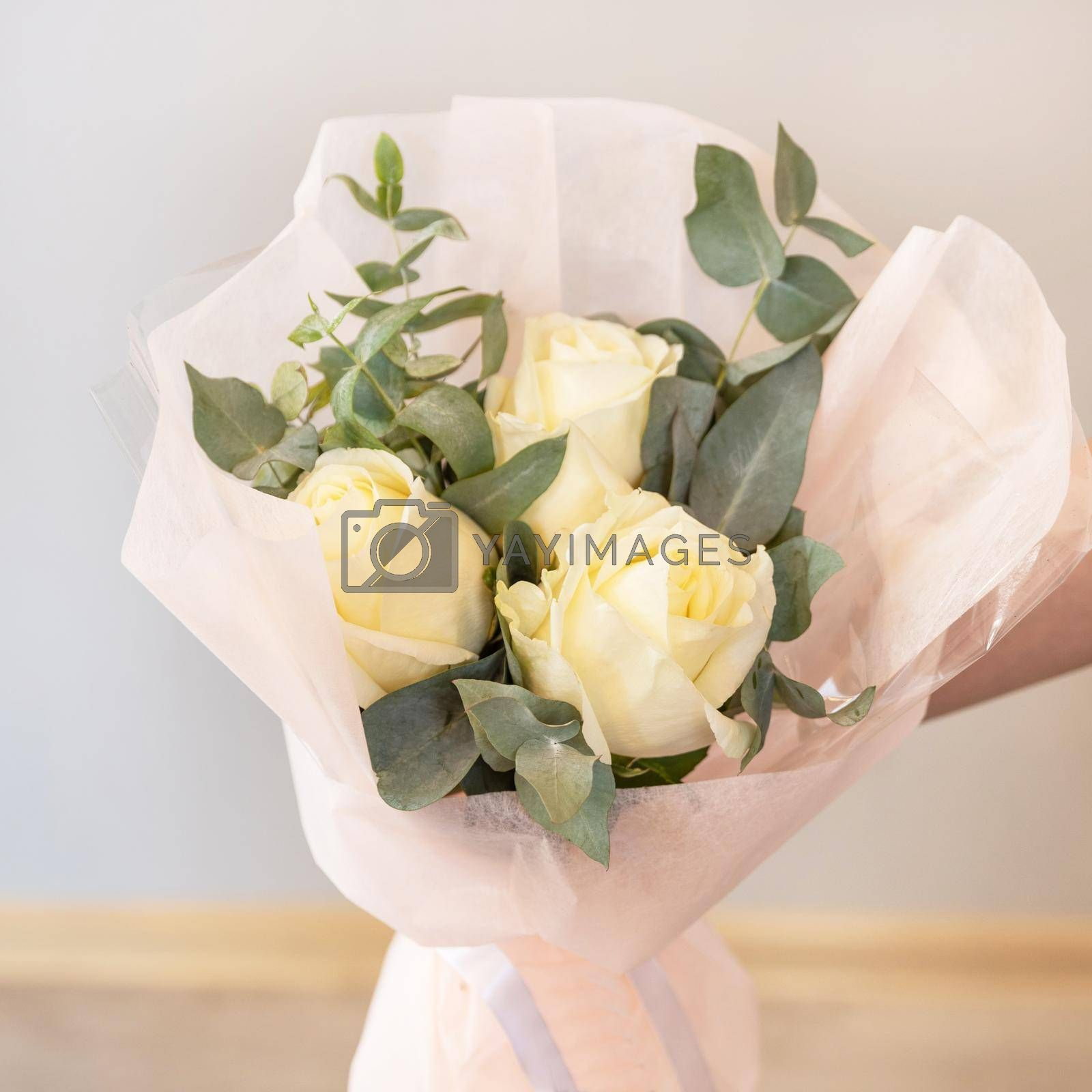 Woman holding white flower bouquet with white background