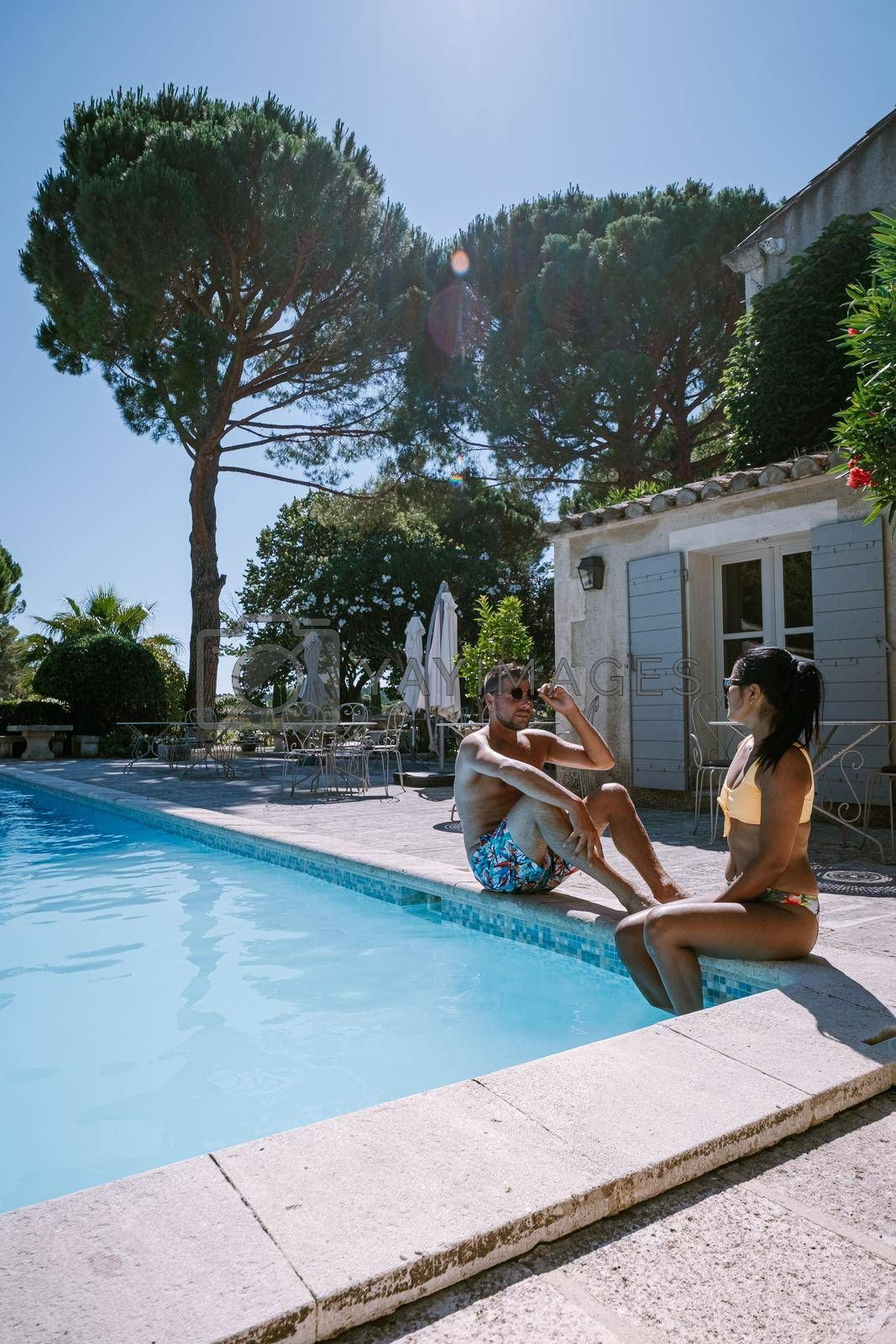couple relaxing by the pool in the Provence France, men and woman relaxing by pool at luxury resort France