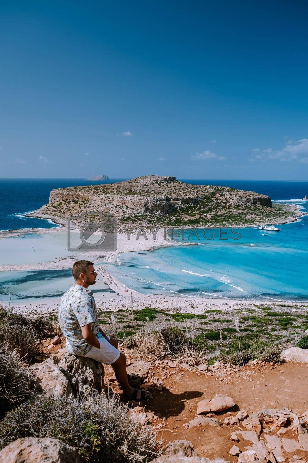Balos Beach Cret Greece, Balos beach is on of the most beautiful beaches in Greece at the Greek Island young guy visit the beach during vacation