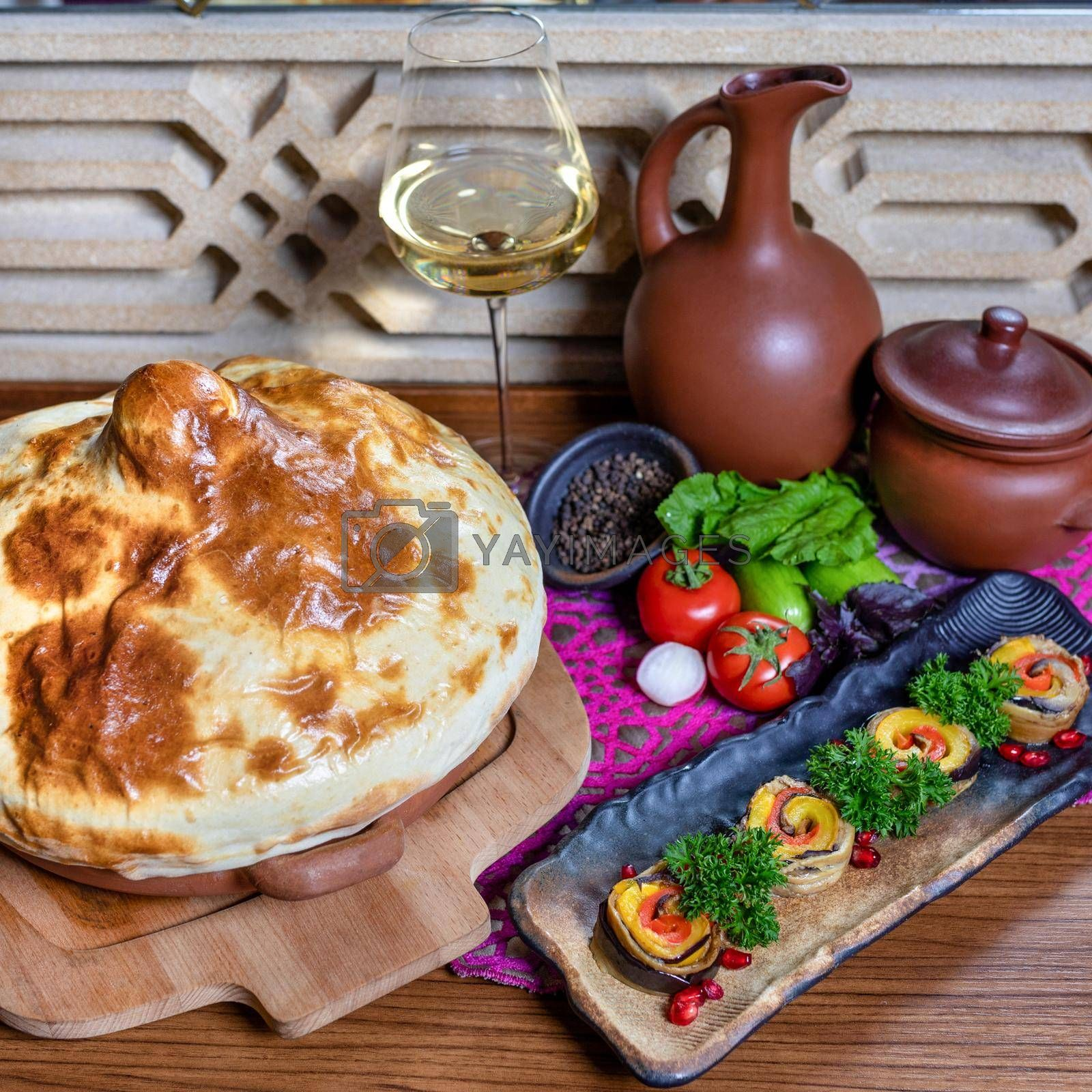 Vegetable snack with bread and white wine glass