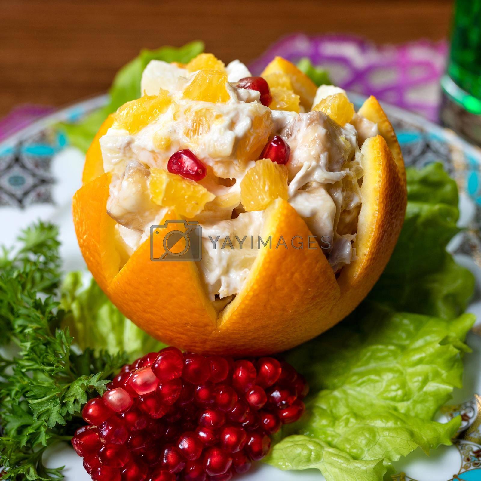 Orange snack with pomegranate close up