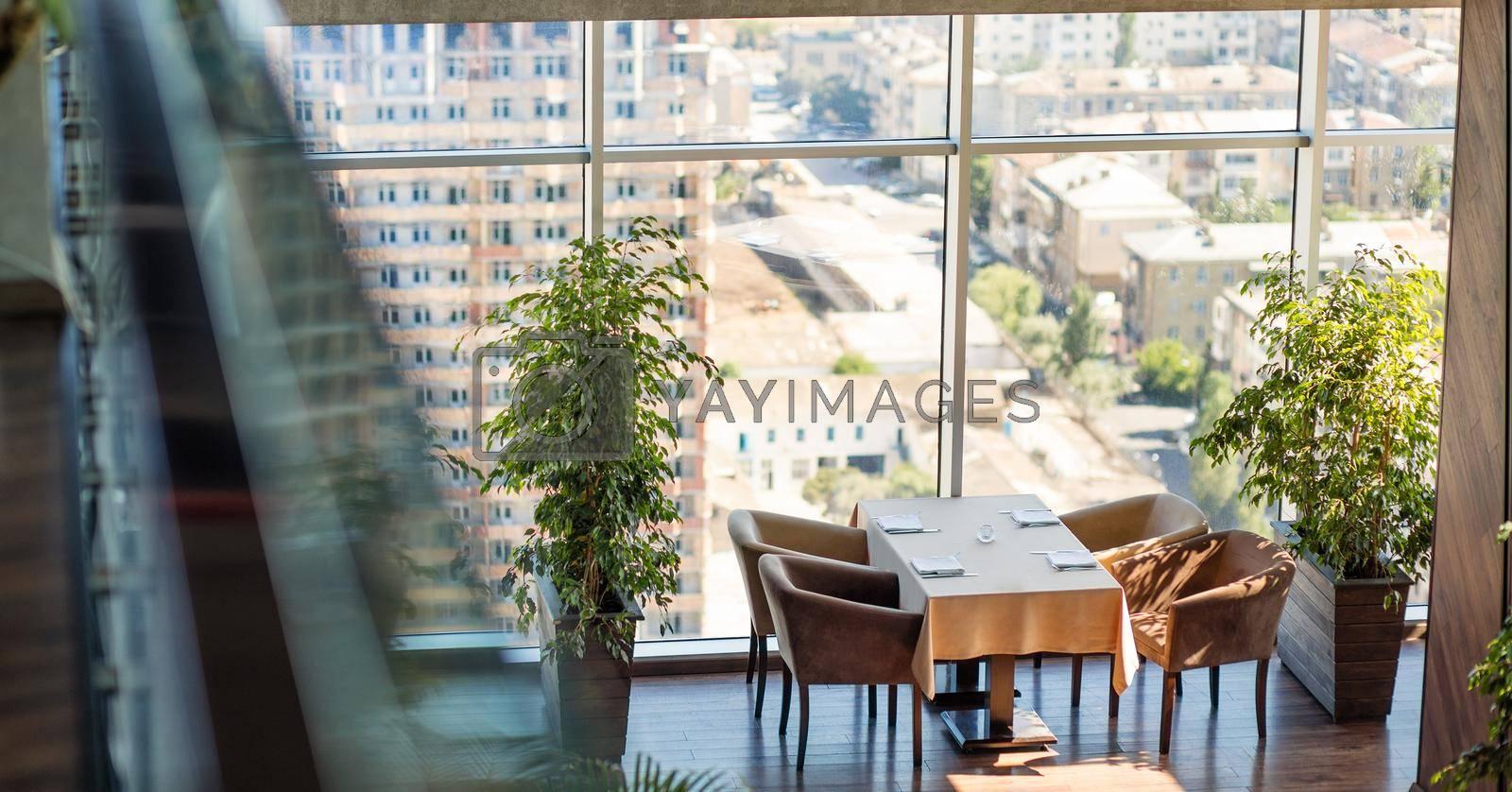 Luxury restaurant interior with city view