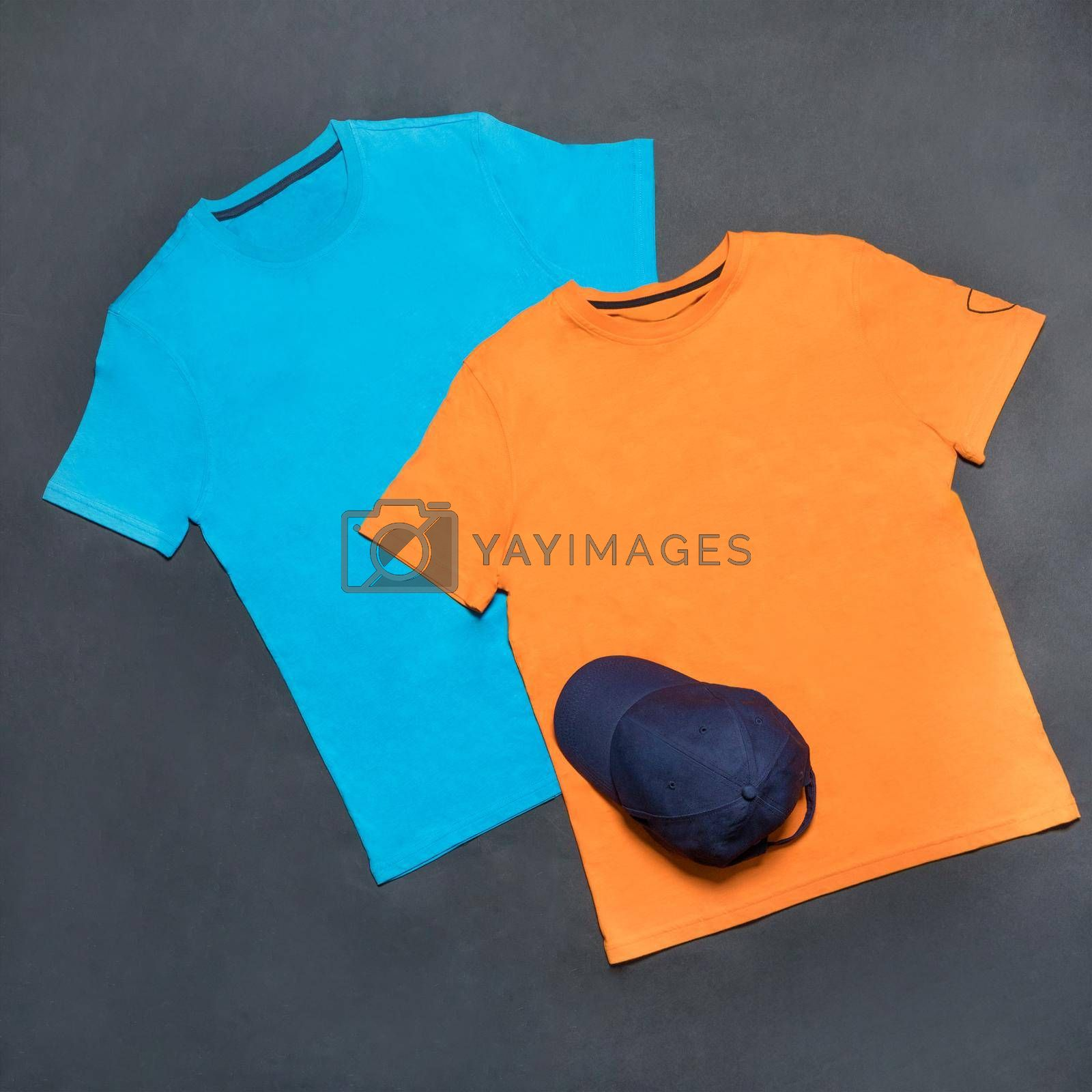 Blue and yellow man sport t-shirt with a blue cap isolated