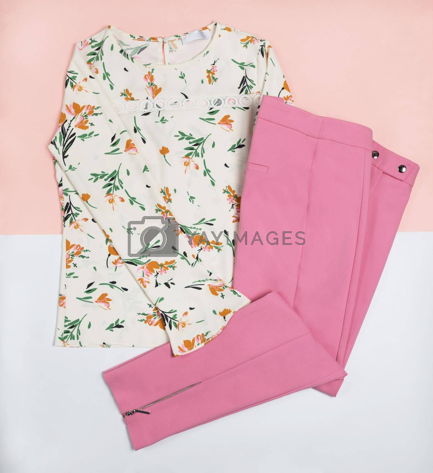 Casual woman dress flower style shirt and a pink pants top view