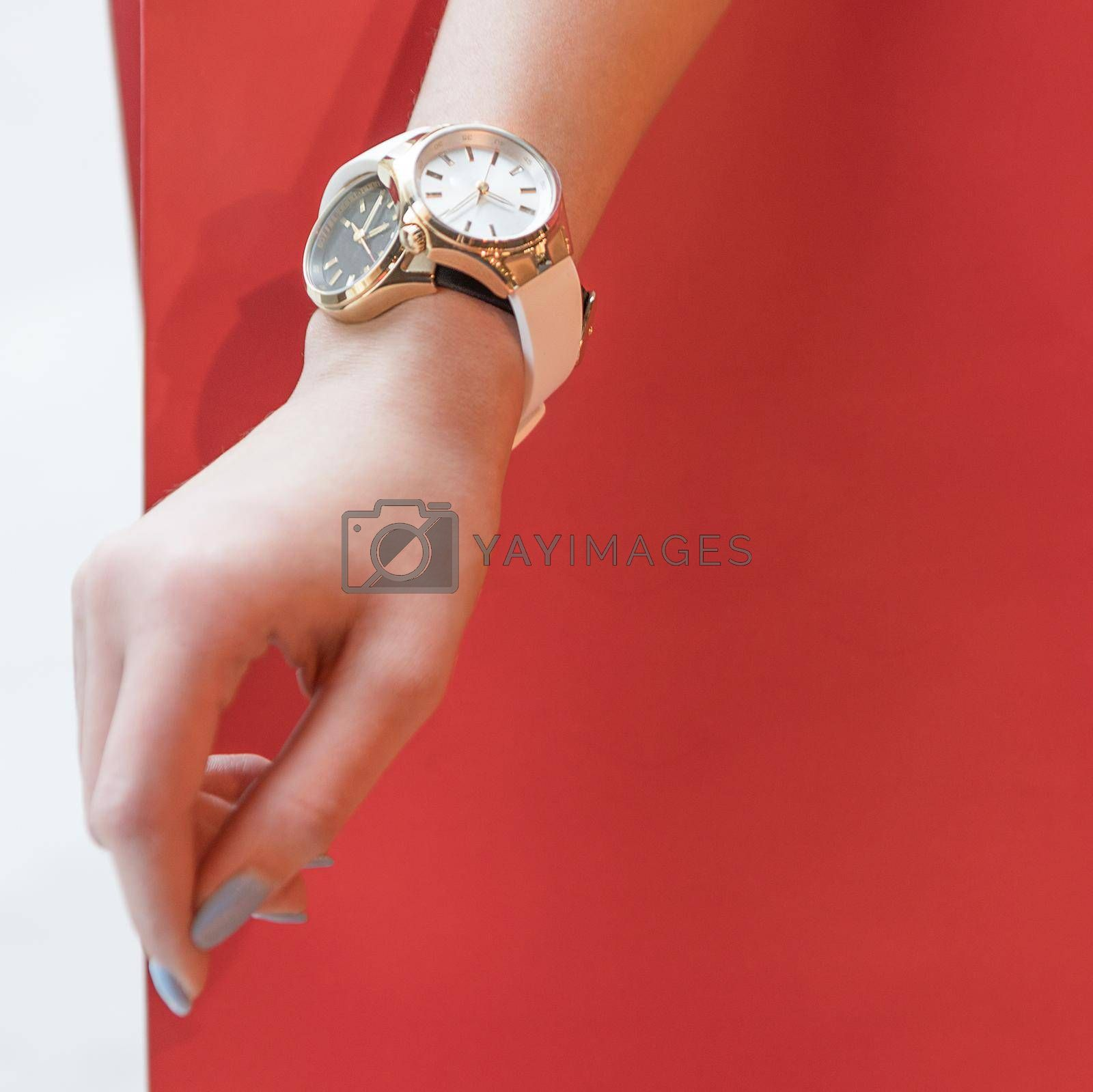 Woman sport style hand watch isolated red background