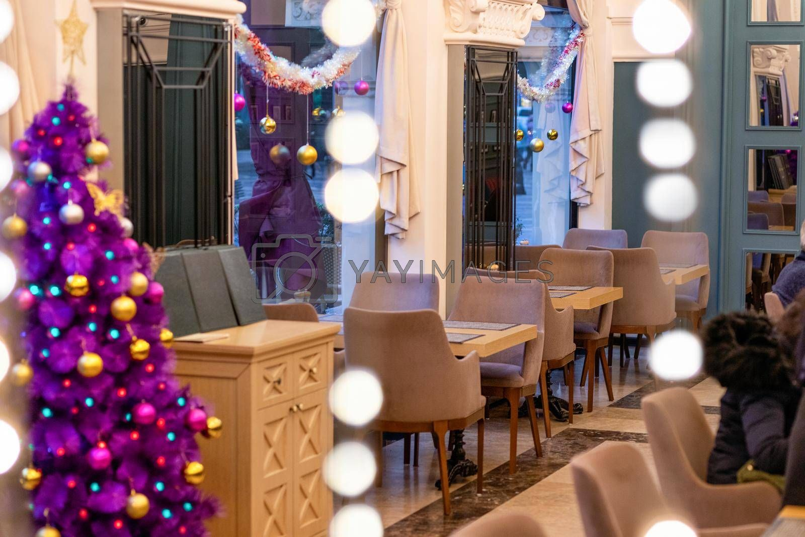 Purple Christmas tree in the restaurant interior