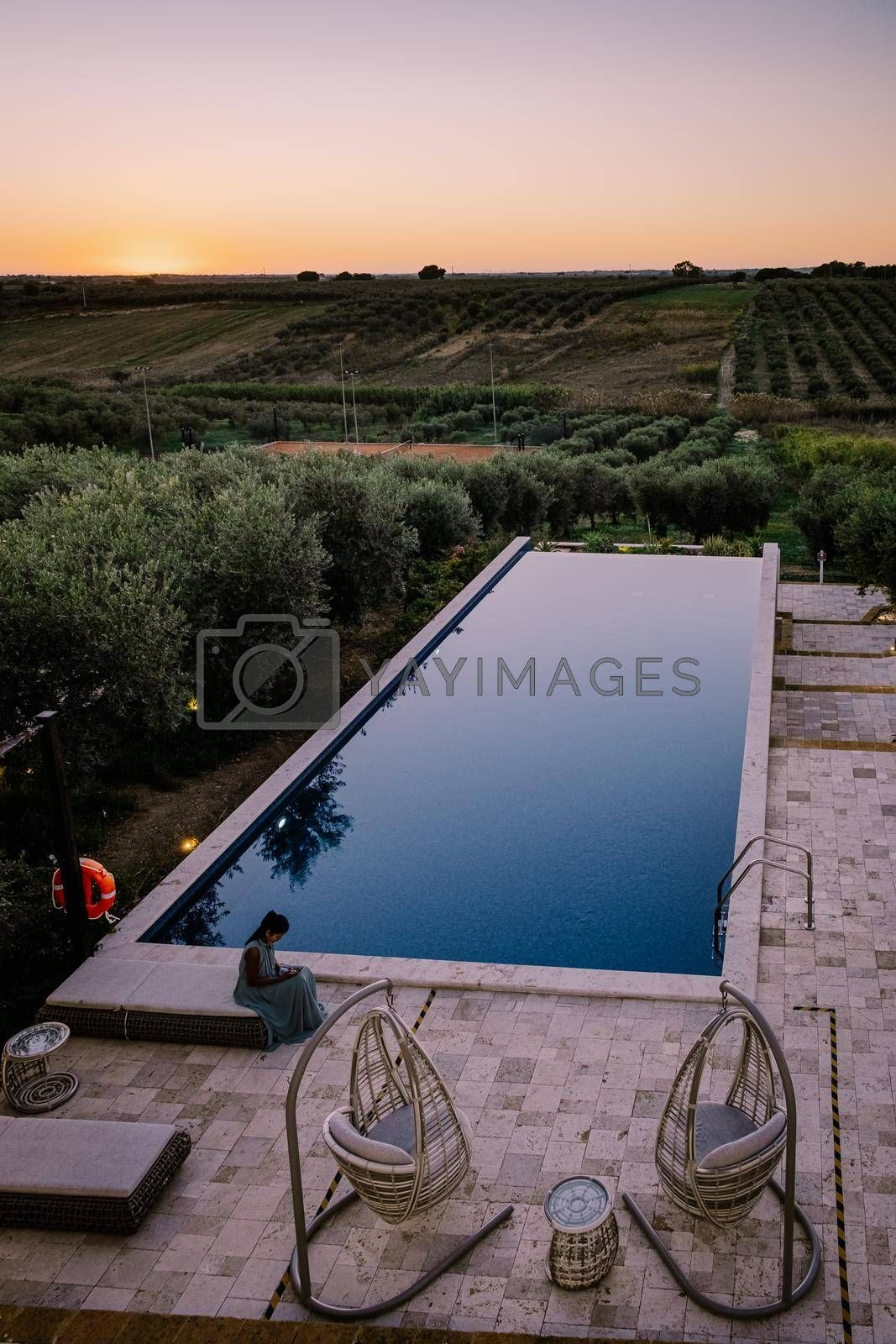 Luxury resort with a view over the wine field in Selinunte Sicily Italy. infinity pool with a view over wine fields in Sicilia, woman on vacation luxury resort