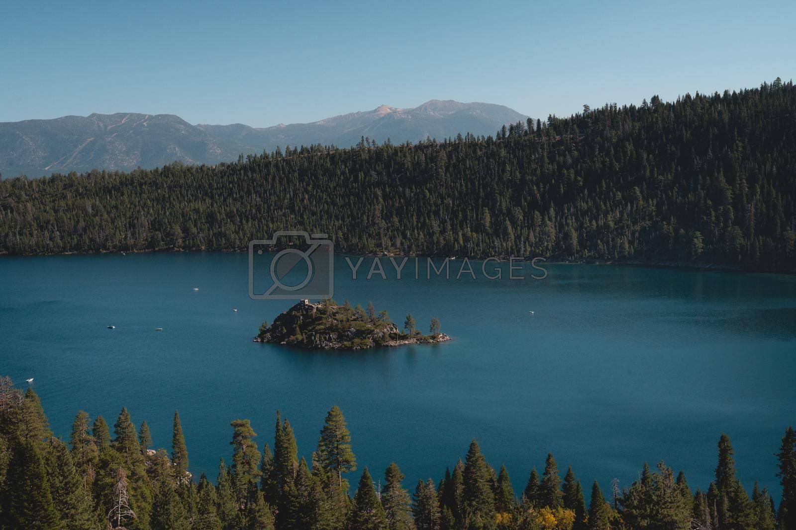 An island in an alpine lake in the mountains.