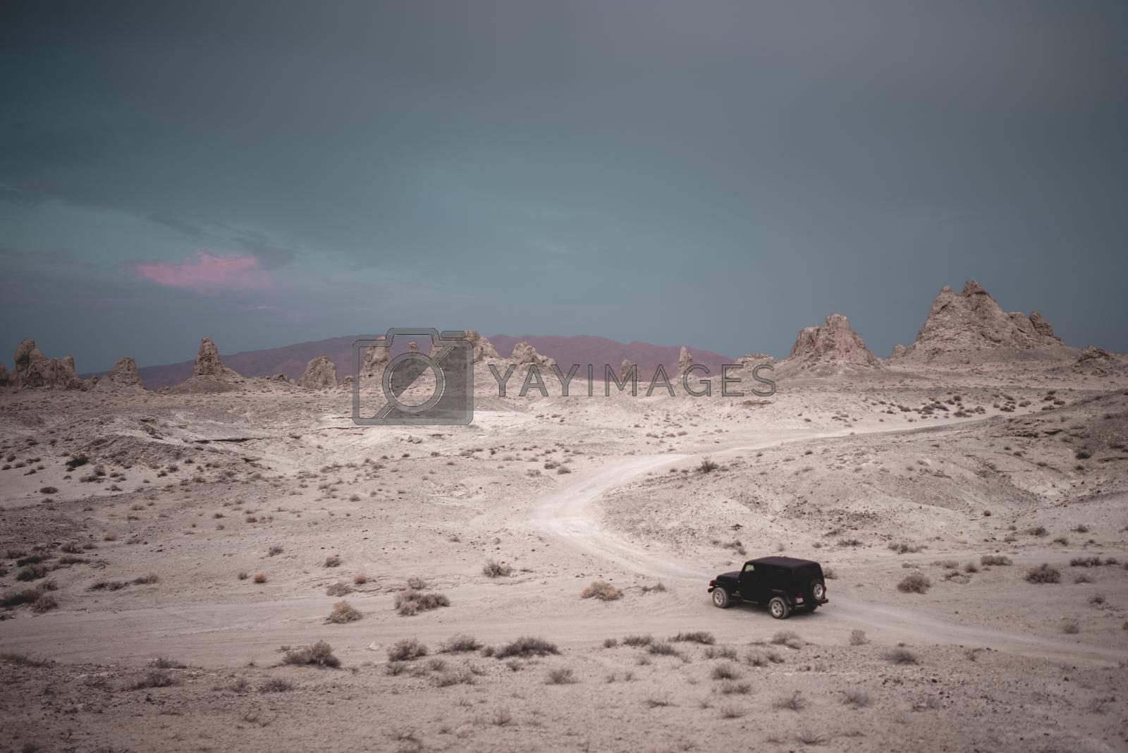 A jeep sits in a desert in California.