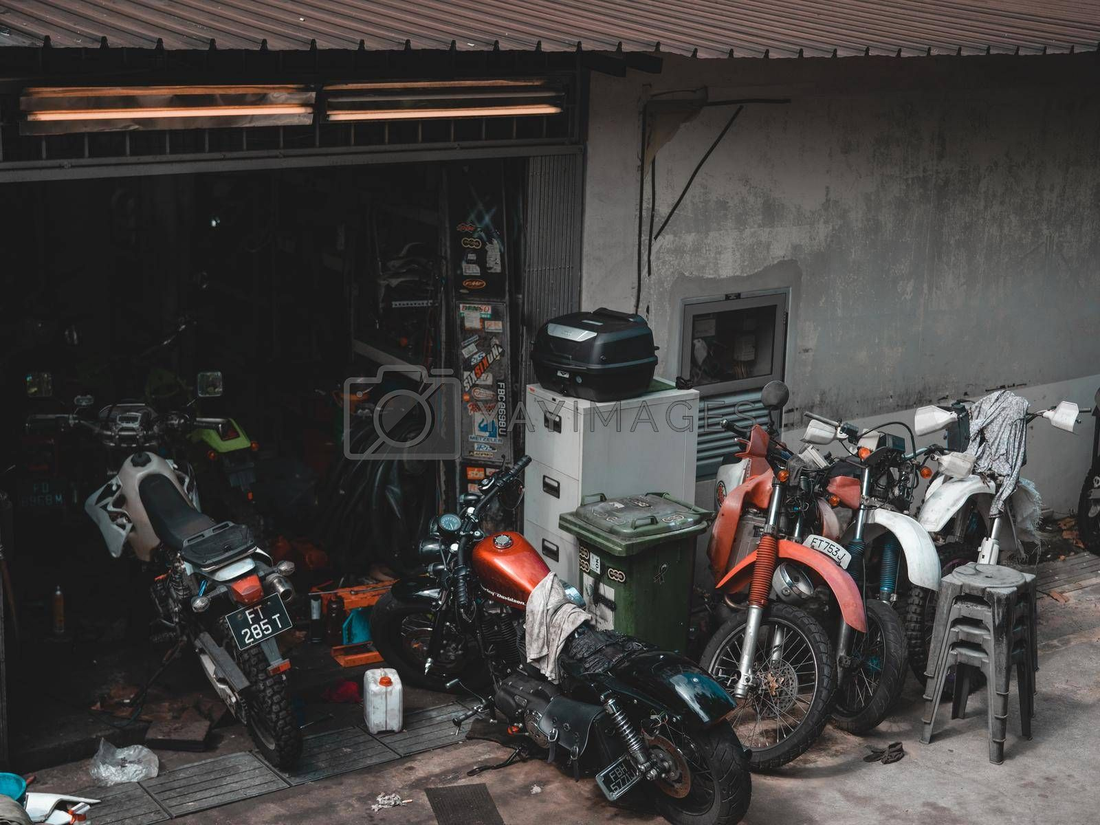 A motorcycle mechanic's garage in Singapore.