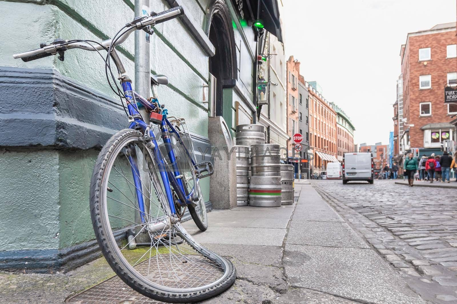 Dublin, Ireland - February 16, 2019: Vandalized bicycle tied up in the city center on a winter day