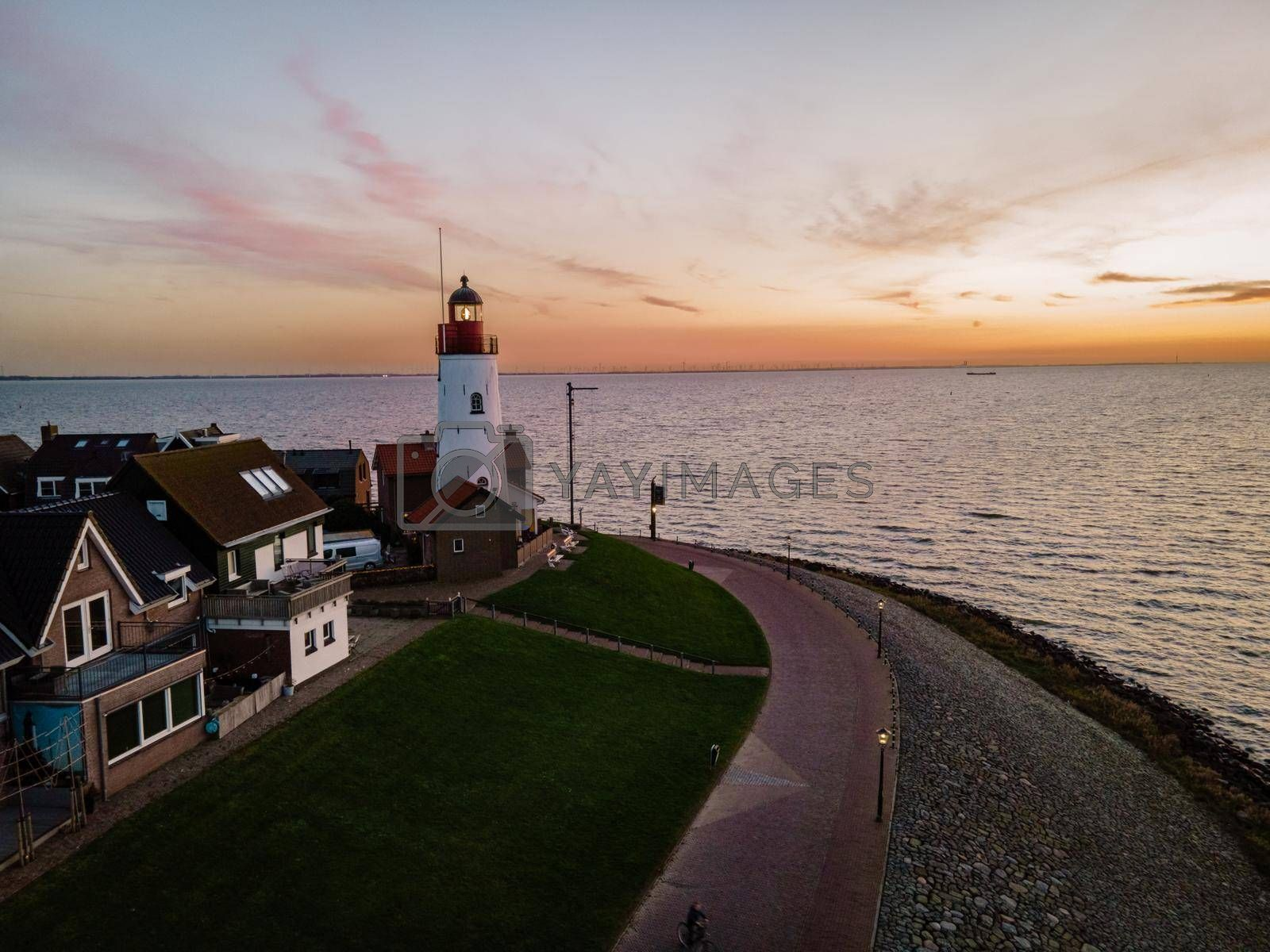 Urk lighthouse with old harbor during sunset, Urk is a small village by the lake Ijsselmeer in the Netherlands Flevoland area by fokkebok