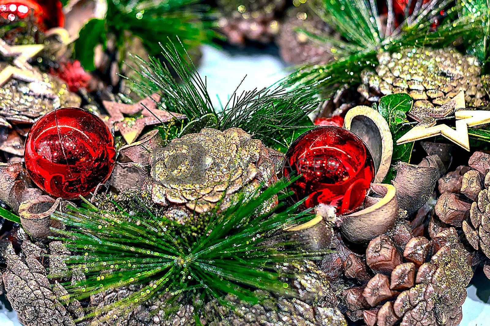 New Year's wreath of cones and Christmas tree branches and balls.