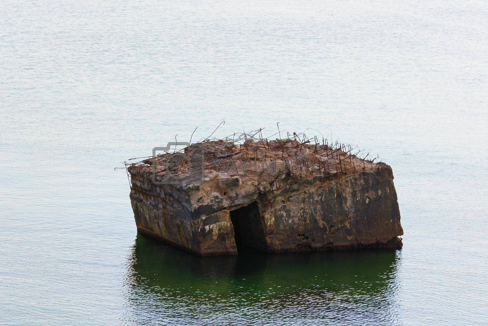 Royalty free image of Abandoned bunker in the sea.            by JFsPic