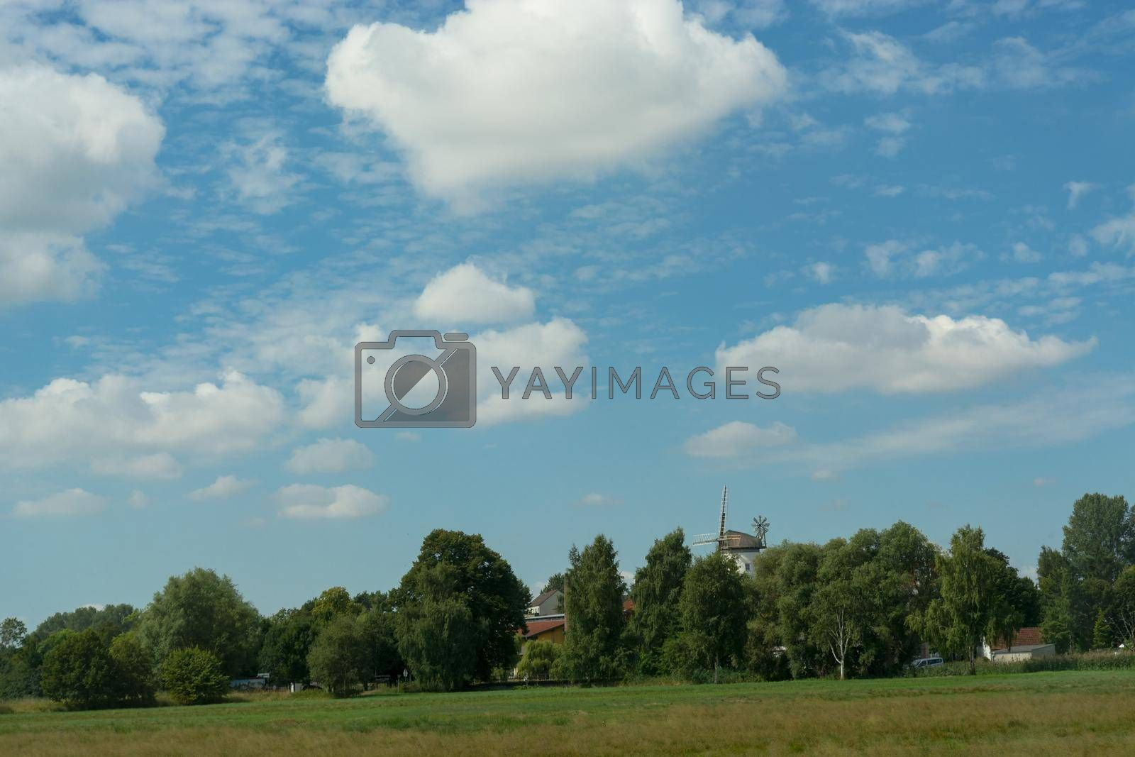 Royalty free image of Scenic panorama with windmill         by JFsPic