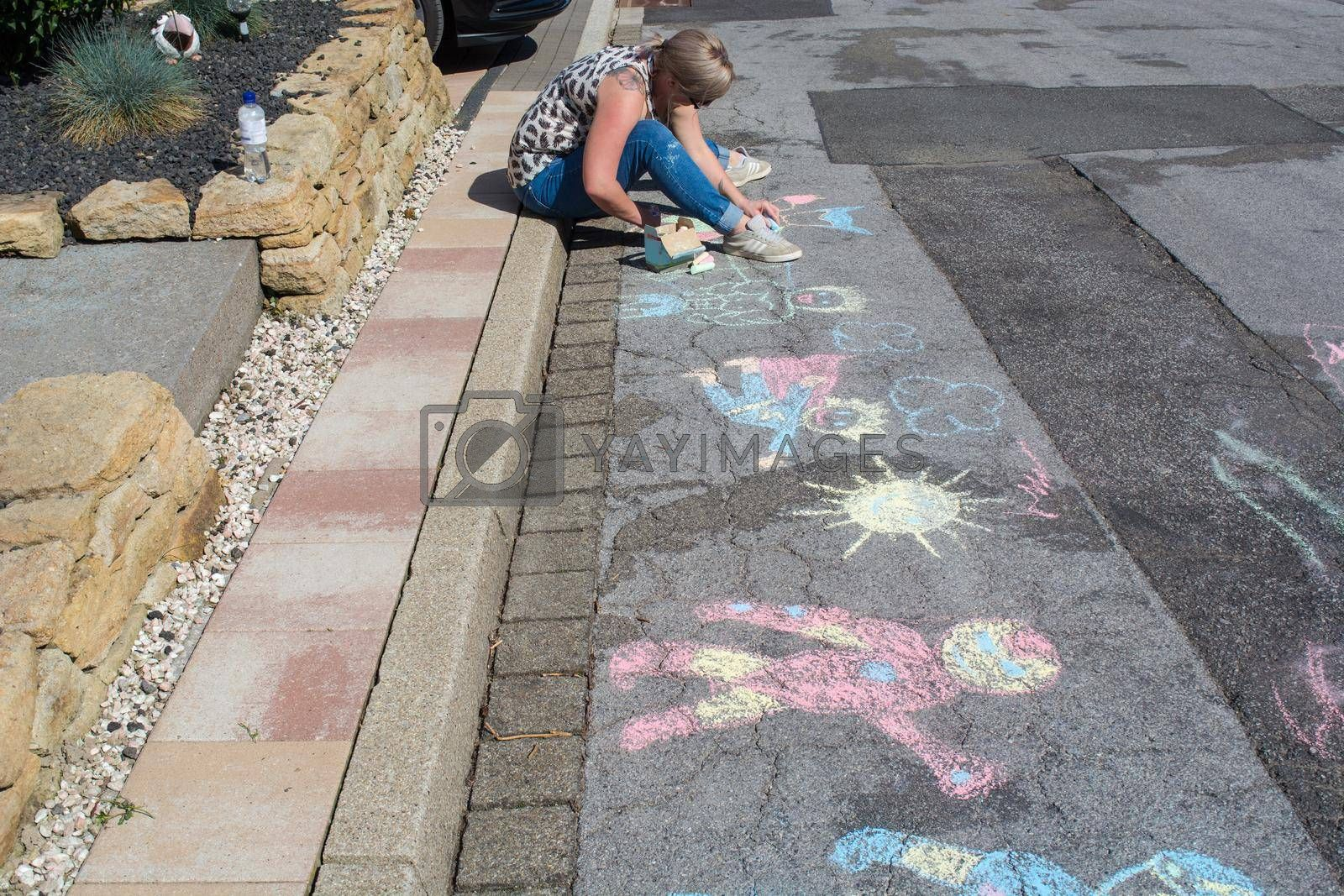 Royalty free image of Chalk paintings on a street by JFsPic